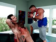 Two hot looking fellow do sensual foreplay on camera.